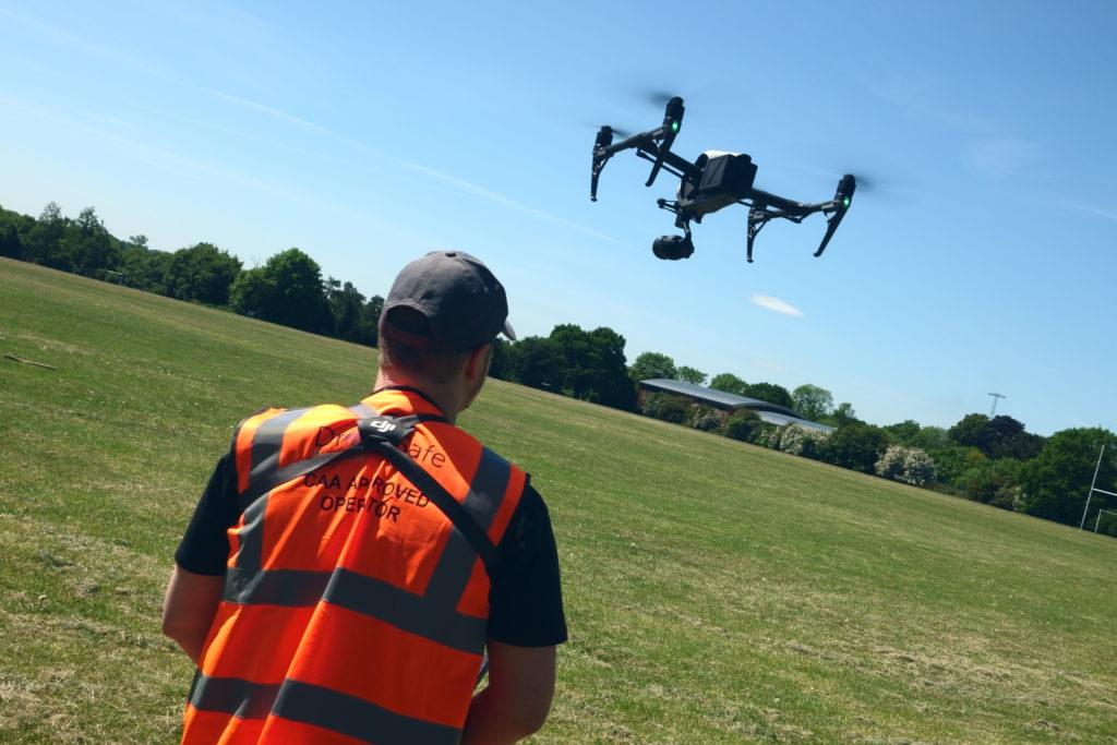 Drone pilot in a field